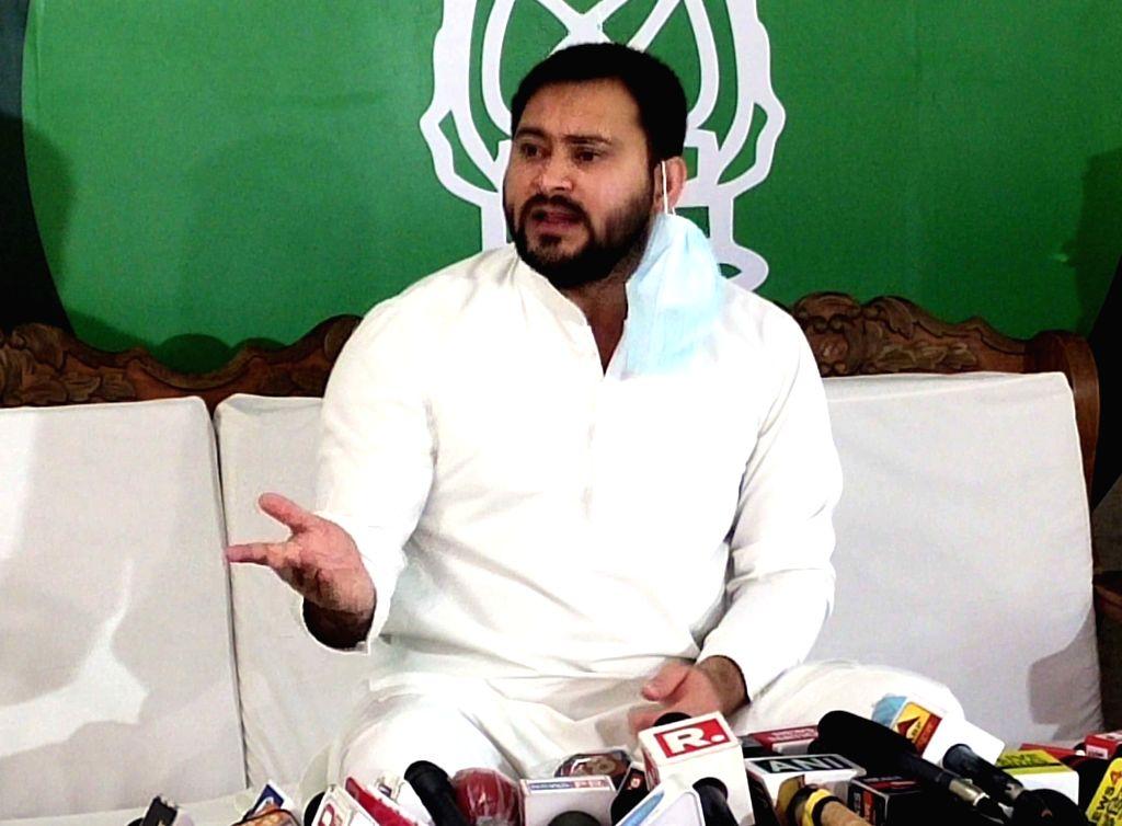 RJD leader Tejashwi Yadav addresses a press conference in Patna on Aug 12, 2020. - Tejashwi Yadav