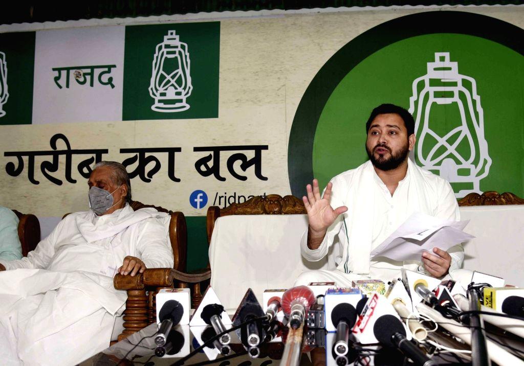 RJD leader Tejashwi Yadav addresses a press conference in Patna on Aug 13, 2020. - Tejashwi Yadav