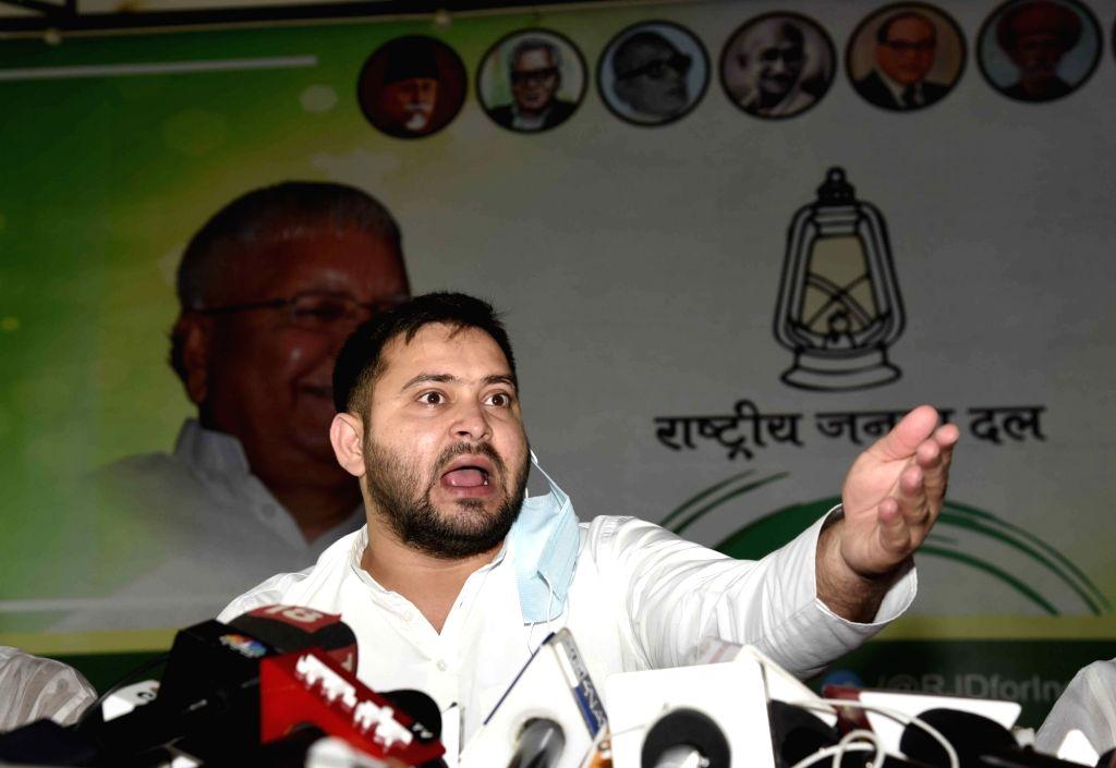 RJD leader Tejashwi Yadav addresses a press conference at Part Office, in Patna on August 29, 2020. - Tejashwi Yadav