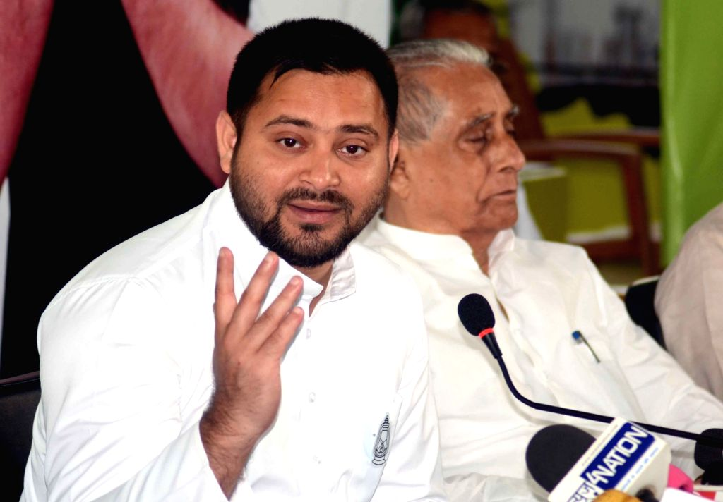 RJD leader Tejashwi Yadav addresses a press conference after releasing the party's election manifesto ahead of Bihar Assembly elections, in Patna on Oct 24, 2020. - Tejashwi Yadav