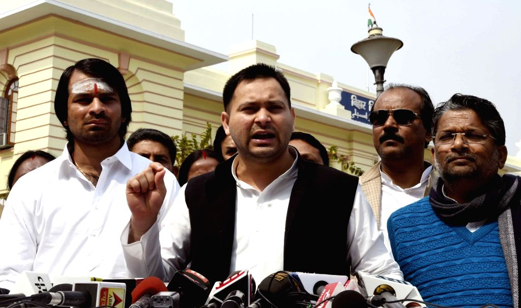 RJD leader Tejashwi Yadav addresses a press conference at Bihar Assembly in Patna on Feb 14, 2019. Also seen his elder brother and party leader Tej Pratap Yadav. - Tejashwi Yadav and Tej Pratap Yadav