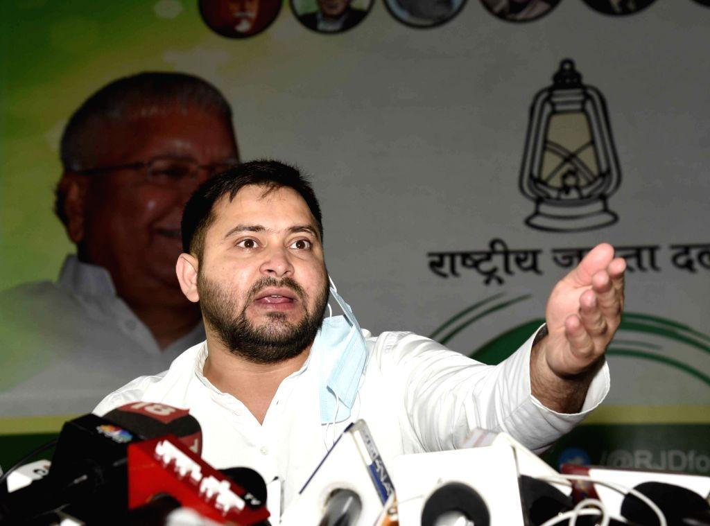 RJD leader Tejashwi Yadav addresses a press conference at Part Office, in Patna on August 29, 2020. (Photo: IANS) - Tejashwi Yadav