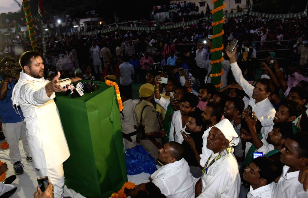 RJD leader Tejashwi Yadav addresses an election rally ahead of the second phase of the Bihar assembly polls, at Raghopur assembly constituency in Vaishali district on Oct 31, 2020. - Tejashwi Yadav