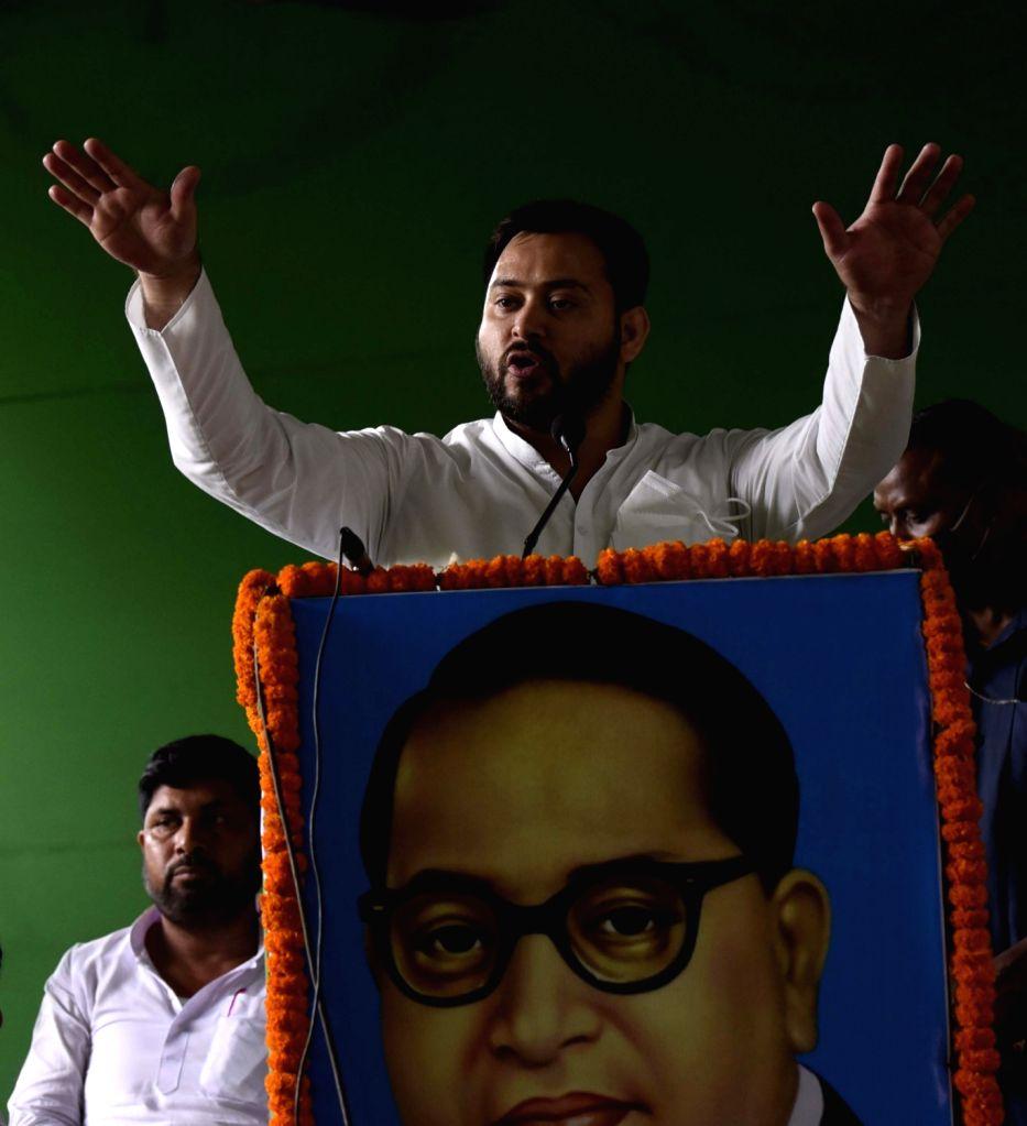 RJD leader Tejashwi Yadav addresses party workers at a party programme in Patna on June 25, 2020. - Tejashwi Yadav