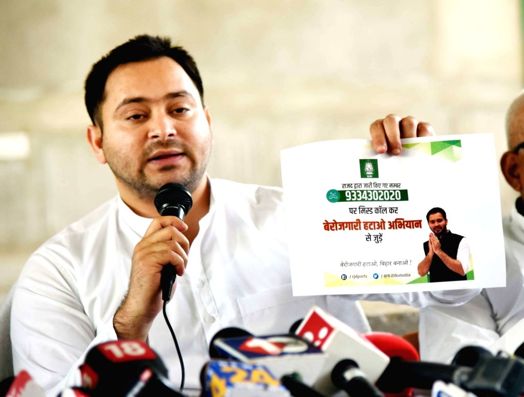 "RJD leader Tejashwi Yadav addresses the media after launching a helpline number as part of their ""Berozgaari Hatao Abhiyaan"" in Patna on March 18, 2020. - Tejashwi Yadav"