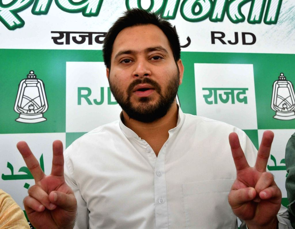 RJD leader Tejashwi Yadav along with other party leaders shows victory sign after the party wrested the Jokihat Assembly seat from the ruling JD-U in Bihar; during a press conference in Patna ... - Tejashwi Yadav