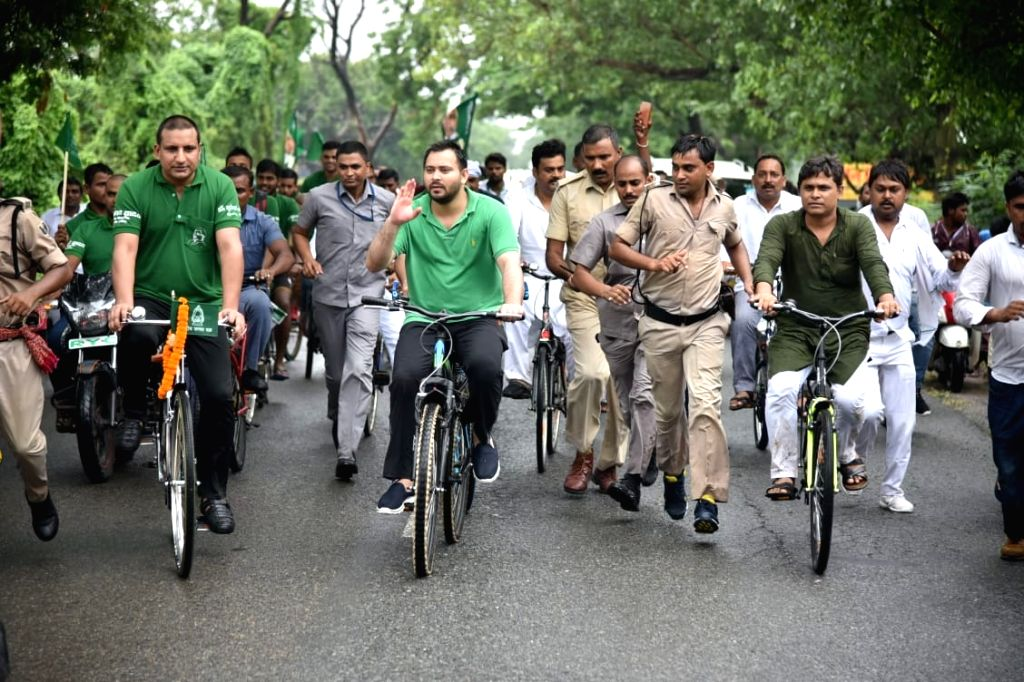 """RJD leader Tejashwi Yadav along with party workers participates in RJD's """"NDA Bhagao, Beti Bachao"""" cycle rally, in Patna on July 28, 2018. - Tejashwi Yadav"""