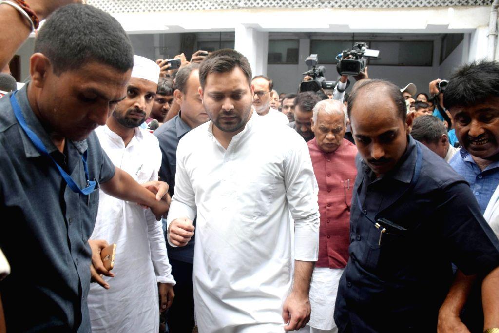 RJD leader Tejashwi Yadav and HAM chief Jitan Ram Manjhi during their visit to the Muzaffarpur Balika Shelter home, on July 25, 2018.The Patna High Court on Wednesday took suo motu ... - Tejashwi Yadav