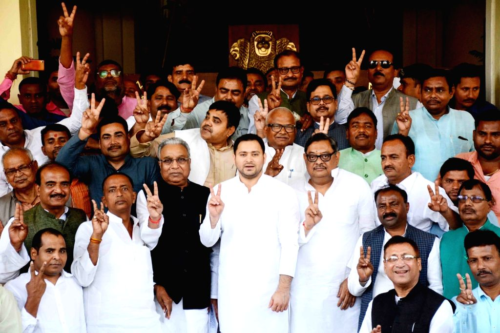 RJD leader Tejashwi Yadav and the party's newly elected members to the Rajya Sabha flash victory sign outside the Bihar Assembly in Patna on March 18, 2020. - Tejashwi Yadav