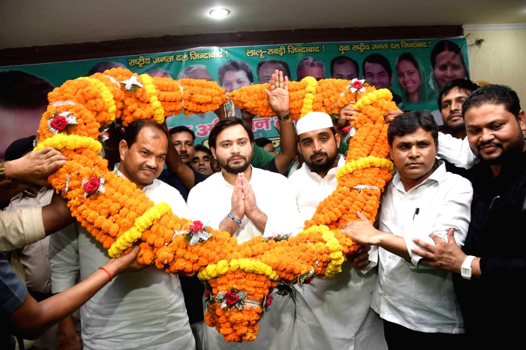 RJD leader Tejashwi Yadav being welcomed on his arrival to chair a party meeting in Patna on Sep 14, 2019. - Tejashwi Yadav