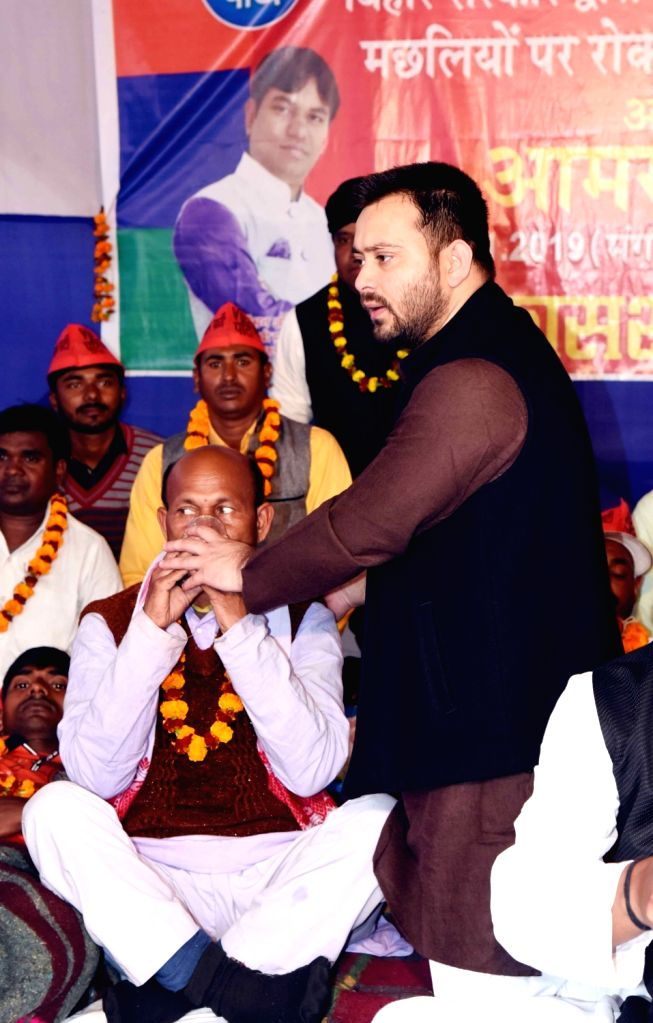 RJD leader Tejashwi Yadav breaks the fast of Vikassheel Insaan Party (VIP) workers who were on a hunger strike to protest against a ban on fish sales in Patna after formalin and lead were ... - Tejashwi Yadav