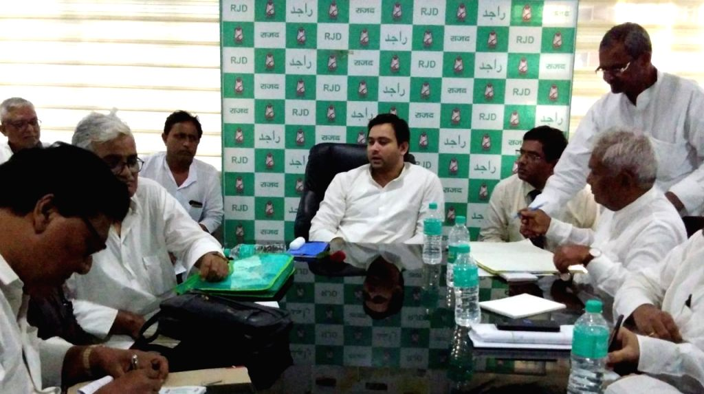 RJD leader Tejashwi Yadav chairs a meeting with party MLAs, in Patna on Aug 26, 2019. - Tejashwi Yadav