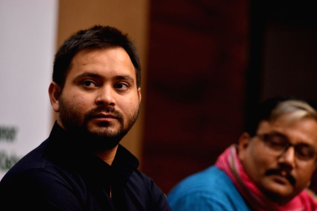 """RJD leader Tejashwi Yadav during an interactive session on """"Role of Youth in Contemporary Politics"""", in New Delhi on Sept 4, 2018. - Tejashwi Yadav"""
