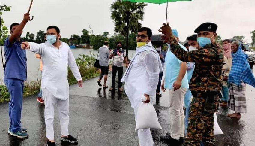 RJD leader Tejashwi Yadav during his visit to the flood-hit regions of Bihar on Aug 1, 2020. - Tejashwi Yadav