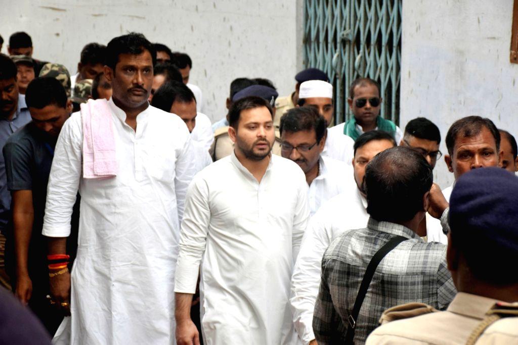 RJD leader Tejashwi Yadav during his visit to the Muzaffarpur Balika Shelter home, on July 25, 2018. The Patna High Court on Wednesday took suo motu cognisance of the rape of over 20 ... - Tejashwi Yadav