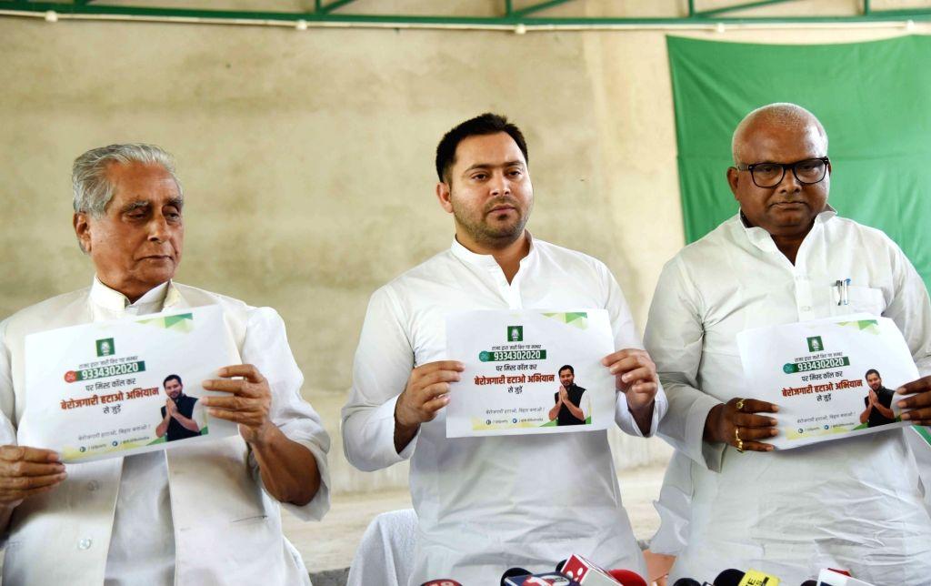 "RJD leader Tejashwi Yadav launches a helpline number as part of their ""Berozgaari Hatao Abhiyaan"" in Patna on March 18, 2020. - Tejashwi Yadav"