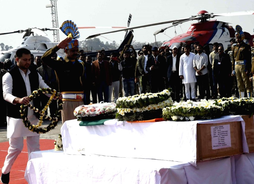 RJD leader Tejashwi Yadav pays tribute to martyrs Ratan Kumar Thakur and Sanjay Kumar Sinha, who were among the 45 CRPF personnel killed in 14 Feb Pulwama militant attack, in Patna on Feb 16, ... - Tejashwi Yadav, Kumar Thakur and Sanjay Kumar Sinha