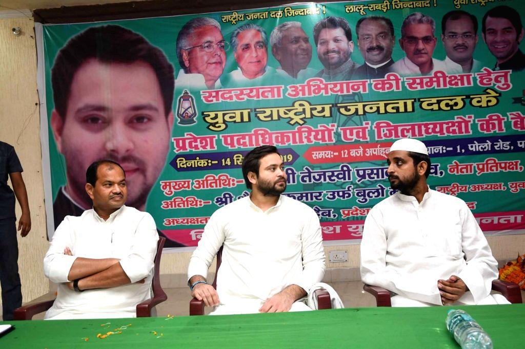 RJD leader Tejashwi Yadav presides over a party meeting in Patna on Sep 14, 2019. - Tejashwi Yadav