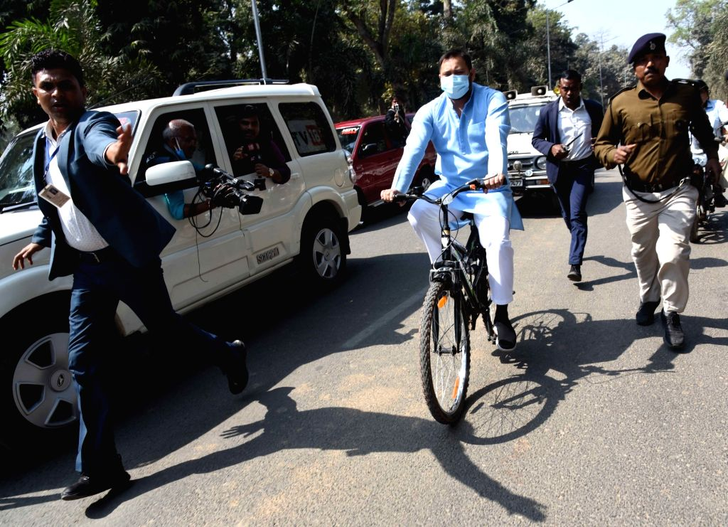 RJD leader Tejashwi Yadav rides a bicycle on his way to reach Bihar Assembly to attend the budget session during a protest against the hike in fuel price, in Patna, Friday, February. 26, 2021. - Tejashwi Yadav