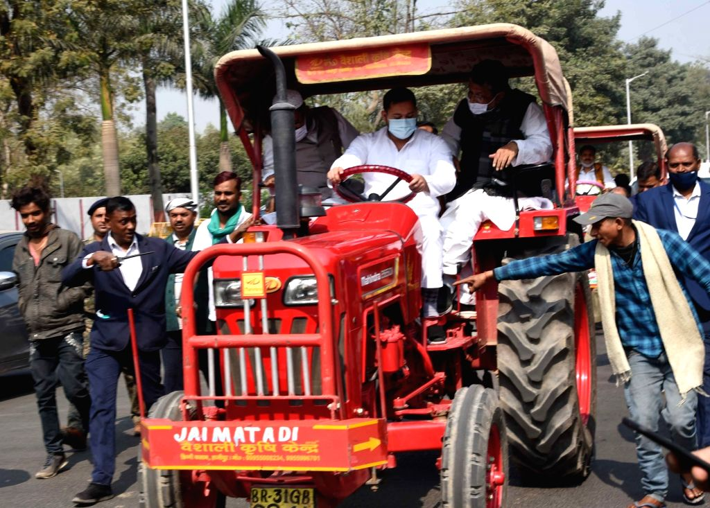 RJD leader Tejashwi Yadav riding a tractor protested against various issues during the budget session of the Bihar Assembly, in Patna on Monday 22nd February, 2021. - Tejashwi Yadav