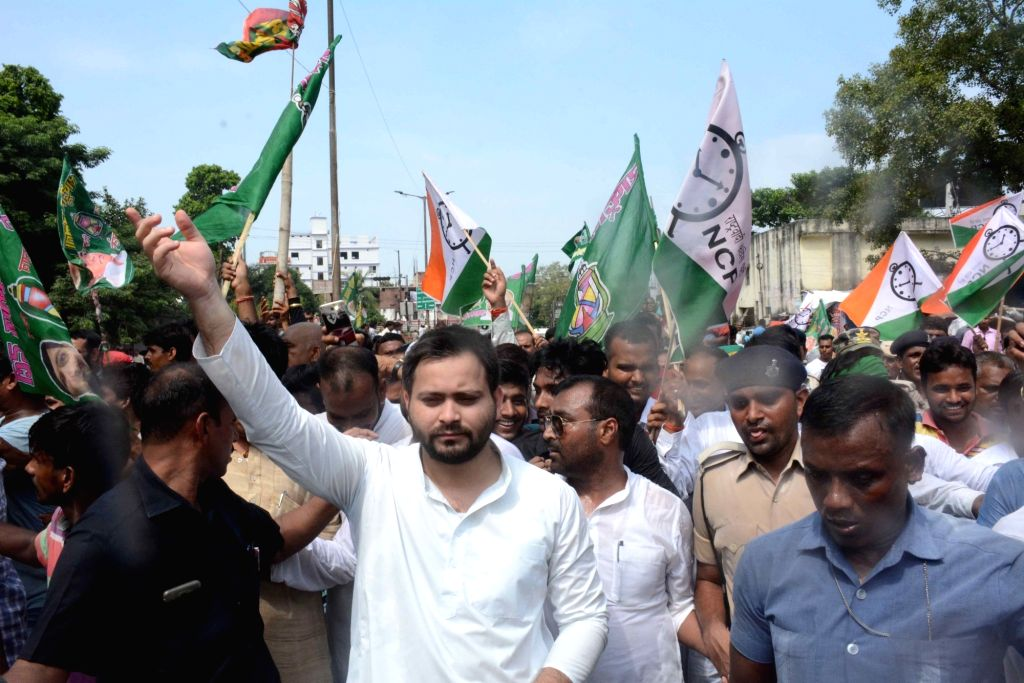 RJD leader Tejashwi Yadav stages a demonstration during a nationwide shutdown protest or 'Bharat Bandh' against rising fuel prices called by opposition parties led by Congress, in Patna on ... - Tejashwi Yadav