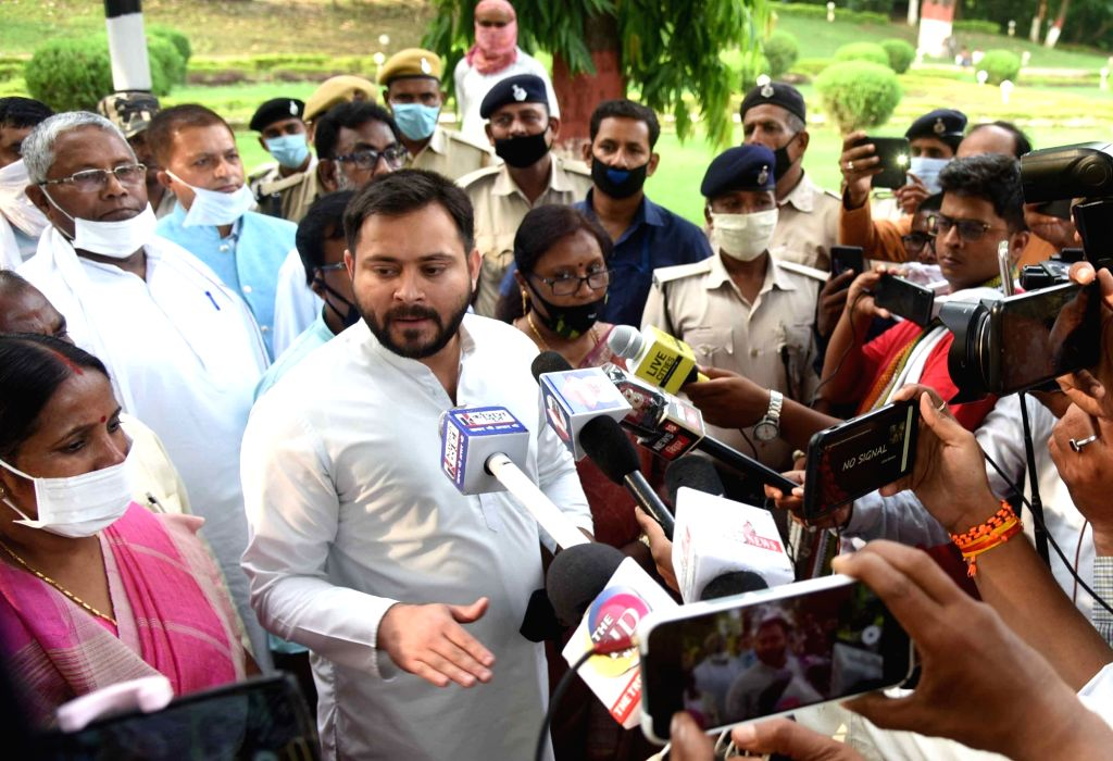 RJD leader Tejashwi Yadav talks to the media after submitting a memorandum to Bihar Governor Phagu Chauhan over the SC/ST Reservation issue, outside Raj Bhavan in Patna on June 23, 2020. - Tejashwi Yadav and Phagu Chauhan
