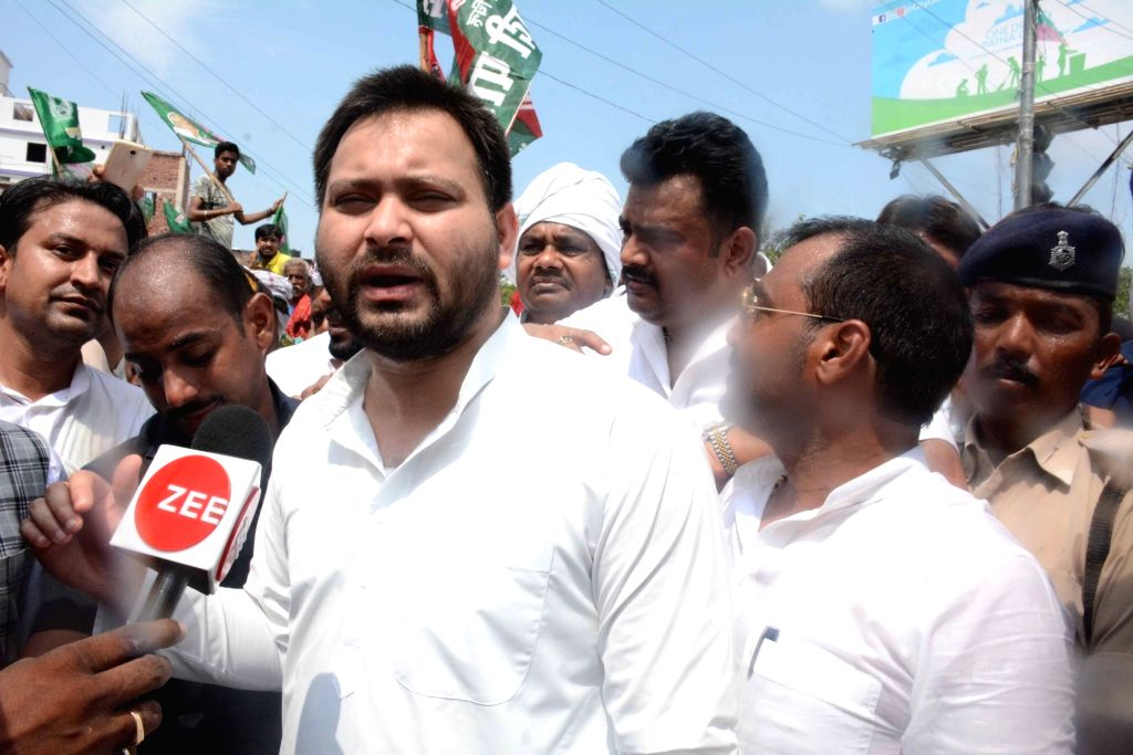 RJD leader Tejashwi Yadav talks to the media during a demonstration amid a nationwide shutdown protest or 'Bharat Bandh' against rising fuel prices called by opposition parties led by ... - Tejashwi Yadav