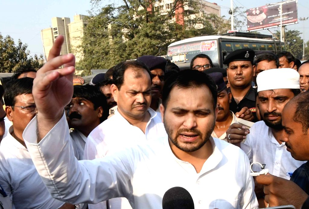 RJD leader Tejashwi Yadav talks to the media during the party's protest march to Raj Bhavan against the Central and the State Governments; in Patna on Nov 4, 2018. - Tejashwi Yadav