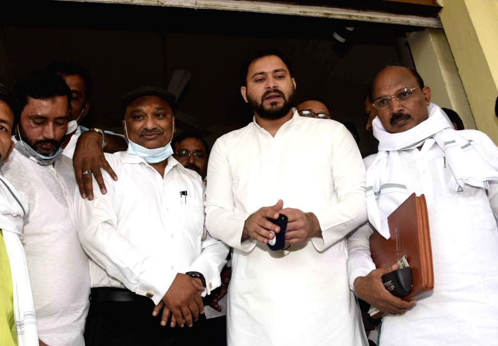 RJD leader Tejashwi Yadav with party's Bihar Legislative Council (MLC) candidates Farooqe Sheikh, Sunil singh and Rambali Singh Chandravansi after their filing of nominations for MLC polls, at ... - Tejashwi Yadav, Farooqe Sheikh and Rambali Singh Chandravansi