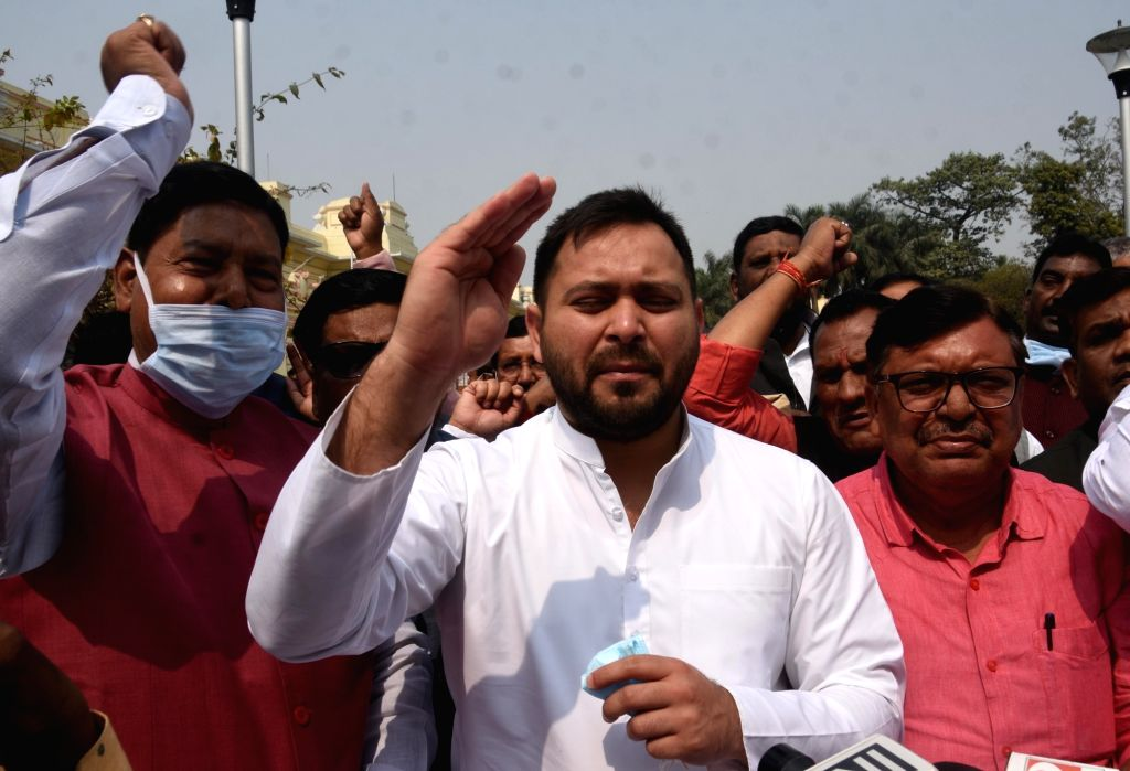 RJD leader Tejashwi Yadav with Party???s legislator stage protest at the Bihar Assembly during the ongoing budget session, in Patna on Tuesday 23rd, 2021. - Tejashwi Yadav