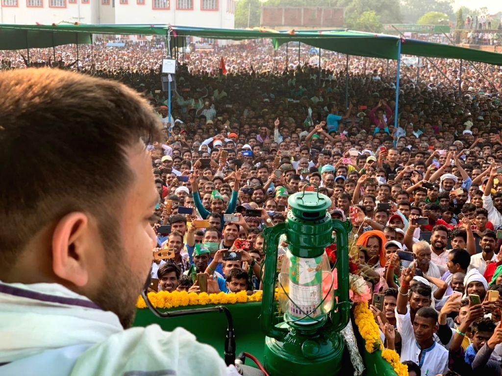 RJD leader Tejaswi Yadav addresses an election rally ahead of Bihar Assembly elections, in Aurangabad on Oct 20, 2020. - Tejaswi Yadav