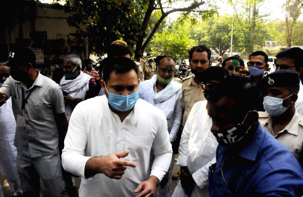 RJD leader Tejaswi Yadav speaks to a media person after Jharkhand high court grants bail to RJD leader Lalu Prasad Yadav in fodder scam case, in Patna, Saturday, April. 17, 2021. - Tejaswi Yadav and Lalu Prasad Yadav