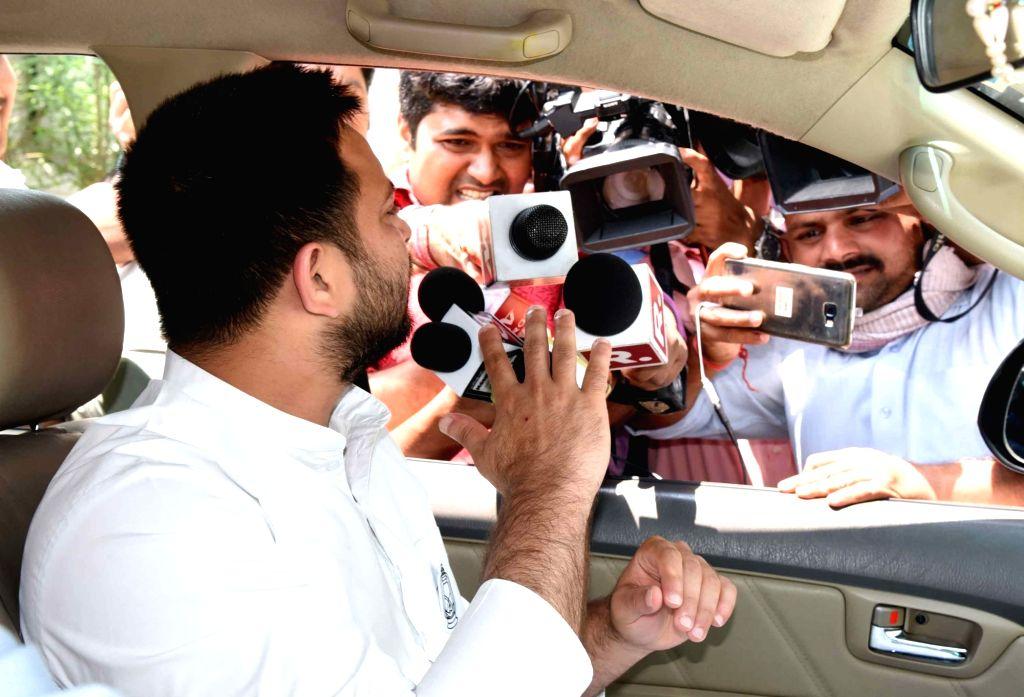RJD leader Tejaswi Yadav talks to media persons, in Patna, on April 25, 2019. - Tejaswi Yadav