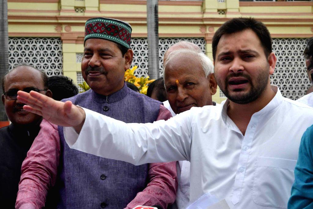 RJD leader Tejaswi Yadav talks to the media outside Bihar Legislative Assembly, in Patna on July 24, 2018. - Tejaswi Yadav
