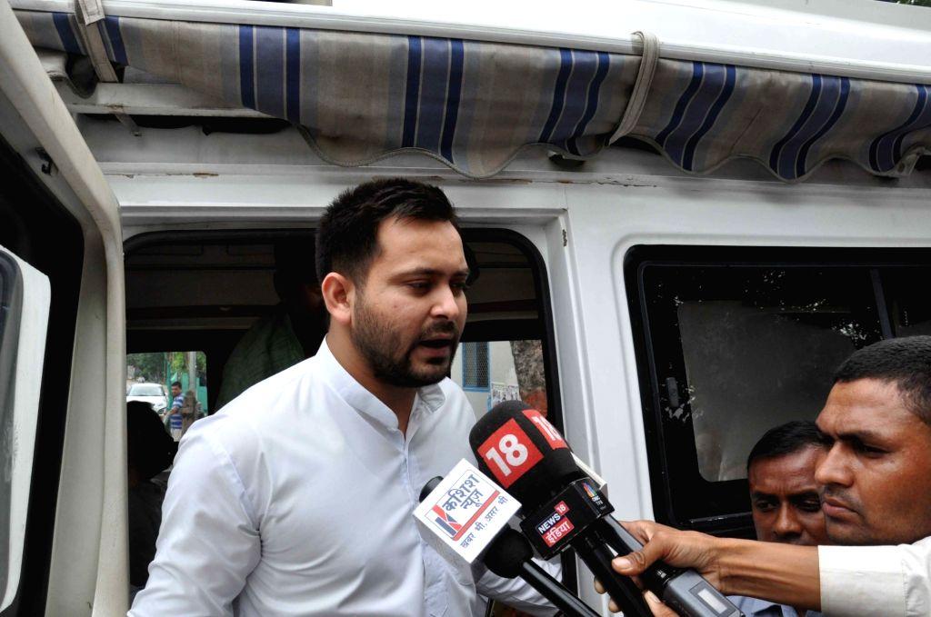 RJD leader Tejaswi Yadav talks to the press, in Patna, on July 26, 2018. - Tejaswi Yadav