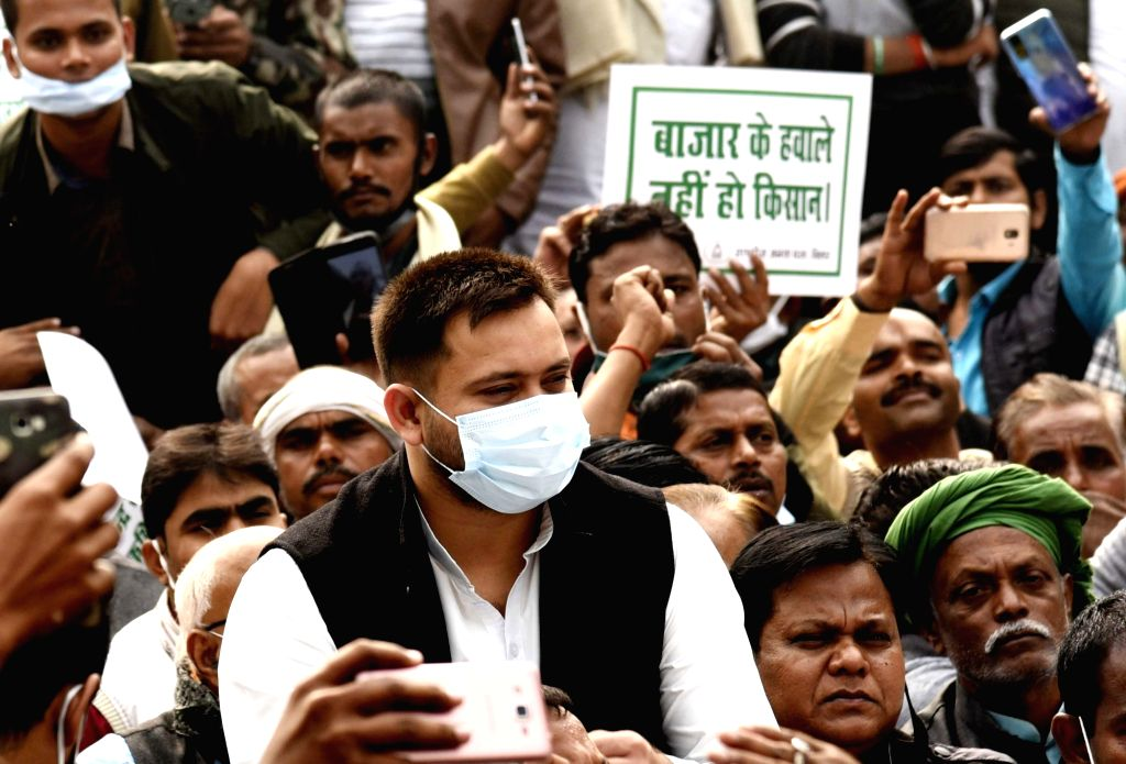 RJD leaders and workers led by party MLA Tejashwi Yadav stage a sit-in demonstration against the Centre's farm laws at Gandhi Maidan in Patna on Dec 5, 2020. - Tejashwi Yadav