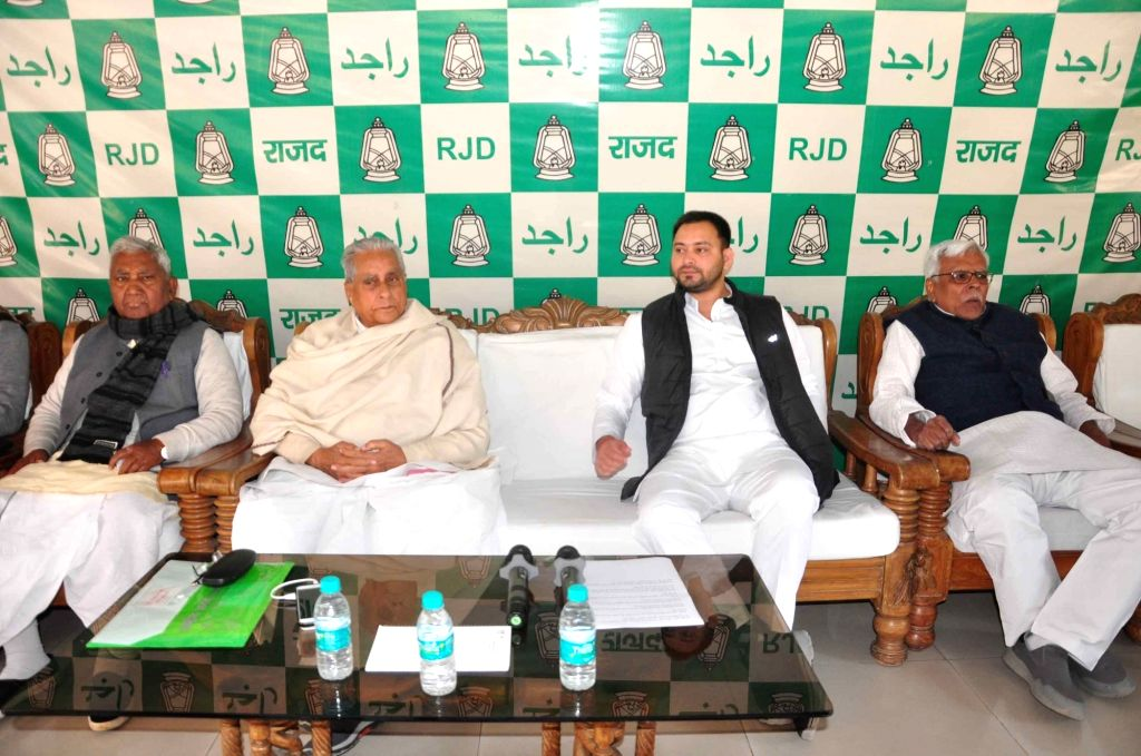 RJD leaders Jagada Nand Singh and Tejashwi Yadav preside over a party meeting in Patna on Feb 9, 2020. - Jagada Nand Singh and Tejashwi Yadav
