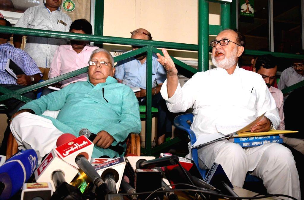 RJD leaders Lalu Prasad Yadav and Abdul Bari Siddiqui during a press conference in Patna on Aug 12, 2017. - Lalu Prasad Yadav