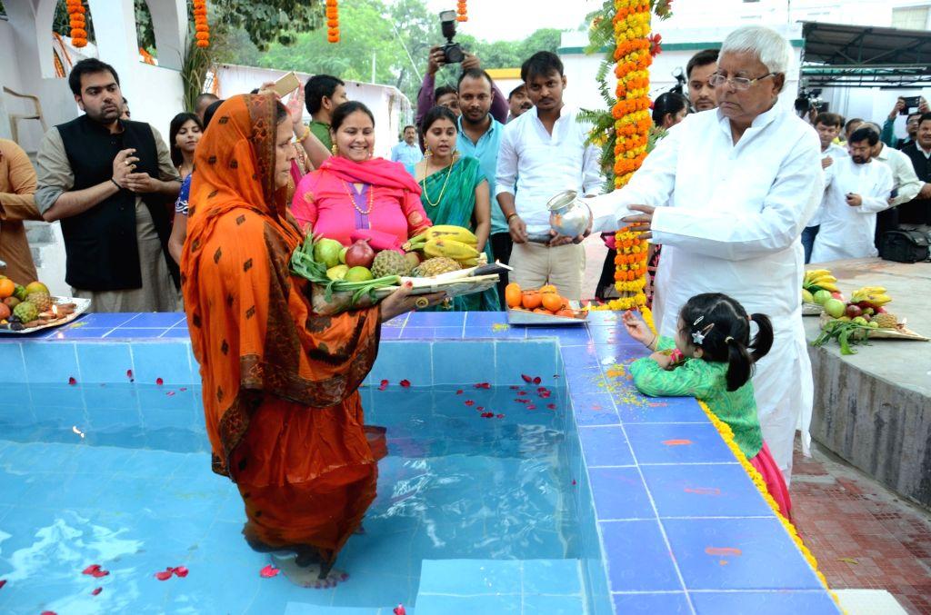 RJD leaders Lalu Prasad Yadav and Rabri Devi celebrate Chhath Puja at their residence in Patna on Nov 17, 2015. - Lalu Prasad Yadav