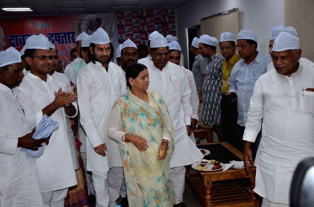 RJD leaders Rabri Devi and Tej Pratap Yadav with HAM-S chief Jitan Ram Manjhi during an iftar party in Patna, on June 3, 2019. - Tej Pratap Yadav