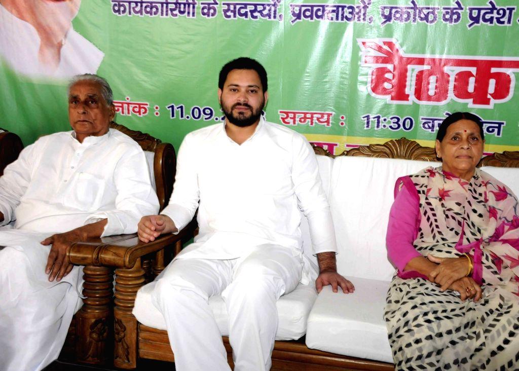 RJD leaders Rabri Devi and Tejashwi Yadav during a party meeting, in Patna on Sept 11, 2018. - Tejashwi Yadav