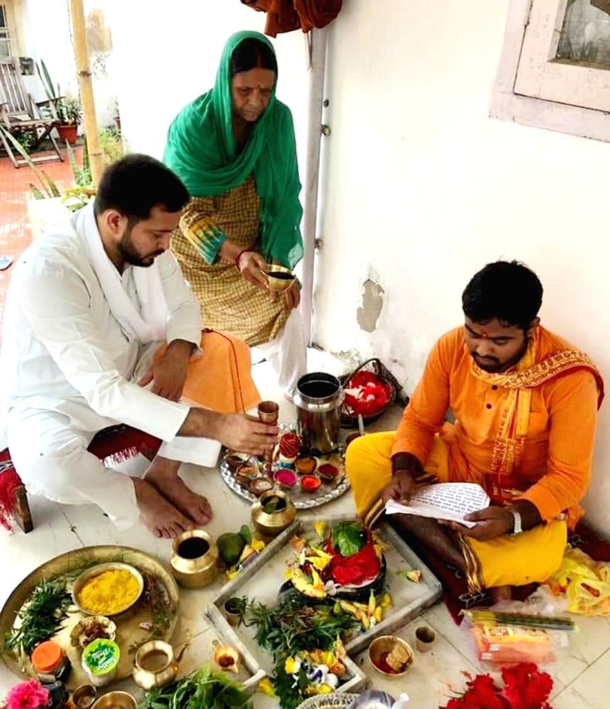 RJD leaders Rabri Devi and Tejashwi Yadav perform rituals on the occasion of the first Monday of Shravan, at their residence in Patna on July 6, 2020. After the celebration of Guru Purnima on ... - Tejashwi Yadav