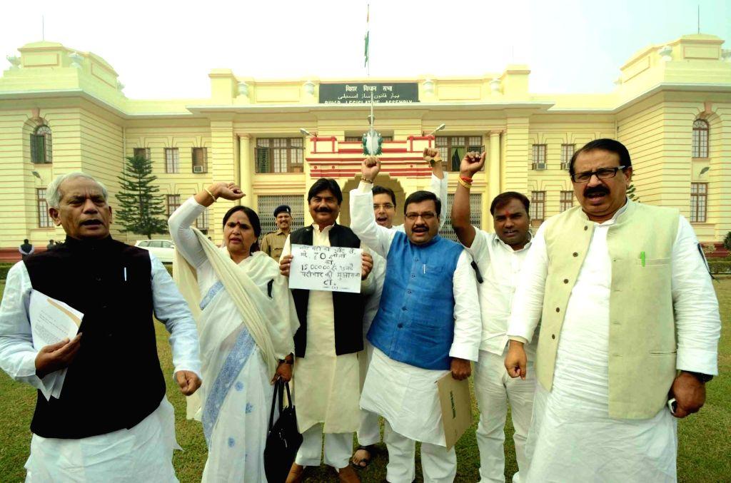 RJD leaders stage a demonstartion against demonetisation outside Bihar Assembly in Patna on Nov 28, 2016.