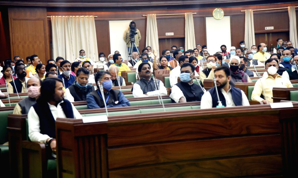 RJD leaders Tej Pratap Yadav and Tejashvi Yadav during the joint sitting of both Houses of Bihar legislature, in Patna on Nov 26, 2020. - Tej Pratap Yadav and Tejashvi Yadav