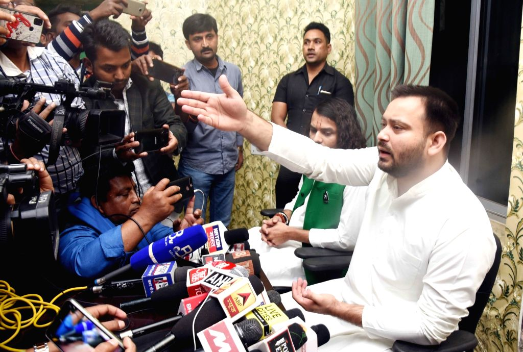 RJD leaders Tej Pratap Yadav and Tejashwi Yadav talk to the media after submitting the nomination papers of jailed party chief Lalu Prasad Yadav for the post of RJD's National President, at ... - Tej Pratap Yadav, Tejashwi Yadav and Lalu Prasad Yadav