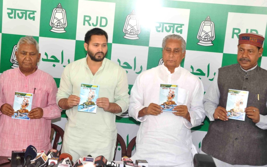 "RJD leaders Tejashwi Yadav and Jagada Nand Singh release ""Arop Patra"" - a compilation of charges against the Nitish Kumar government, in Patna on April 4, 2018. - Tejashwi Yadav, Jagada Nand Singh and Nitish Kumar"