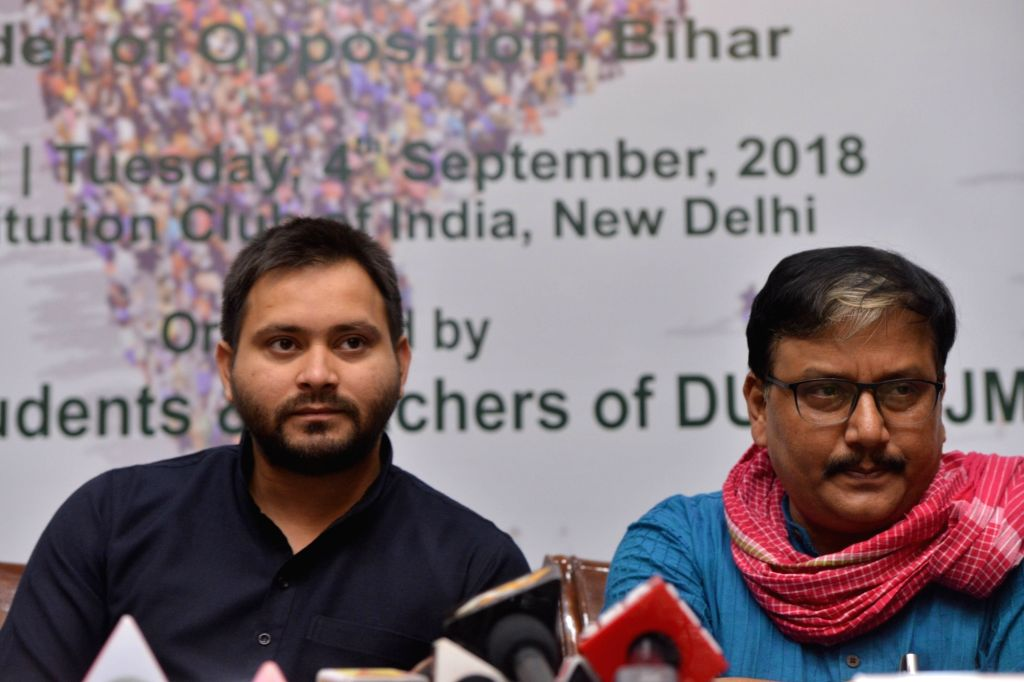 """RJD leaders Tejashwi Yadav and Manoj Jha during an interactive session on """"Role of Youth in Contemporary Politics"""", in New Delhi on Sept 4, 2018. - Tejashwi Yadav"""