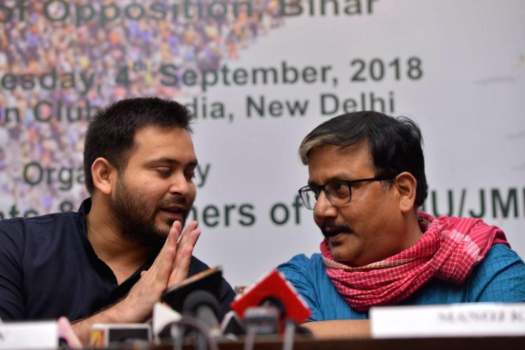 """RJD leaders Tejashwi Yadav and Manoj Jha during a conversation at an interactive session on """"Role of Youth in Contemporary Politics"""", in New Delhi on Sept 4, 2018. - Tejashwi Yadav"""