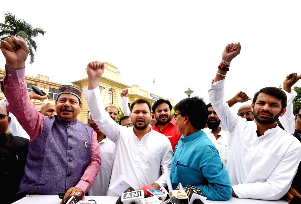 RJD leaders Tejashwi Yadav and Tej Pratap Yadav talk to the media outside Bihar Legislative Assembly, in Patna on July 24, 2018. - Tejashwi Yadav and Tej Pratap Yadav