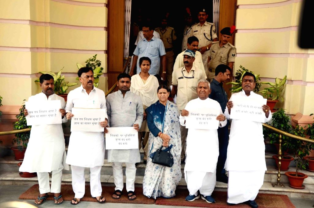 RJD legislators led by party MLAs Ram Chandra Purbey and Rabri Devi, protest against lathi-charge on party workers and teachers during a demonstration, at Bihar Assembly in Patna on July 19, ...